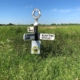 traditional black and white finger post sign giving directions to South Mundham, Honer, Runcton, Fisher and Bowley
